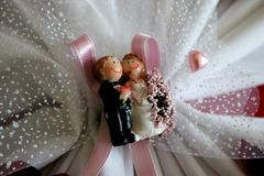 Wedding newlyweds couple magnet figurine ceramics royalty free stock photo