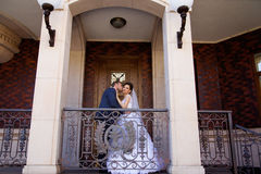 Wedding newlyweds kiss on a sunny day Royalty Free Stock Photo