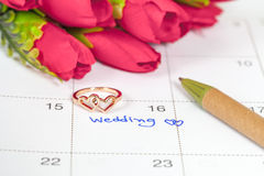 Wedding note on a calendar sets a reminder Royalty Free Stock Image
