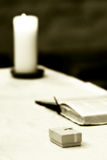 Wedding objects in church. A box containing wedding rings near a candle and bible on the church altar Stock Images