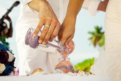 Tropical wedding. Sand ceremony. Wedding in a nautical style stock photo