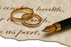 Wedding - Old Style. Two wedding ring and a pen laying on the old burned paper. I will be very happy if you let me know when you use this image in your project Royalty Free Stock Photo