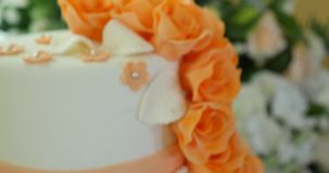 Wedding orange cake with flowers stock video footage