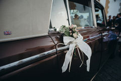 Wedding ornament decoration in a classic car. Stock Photo