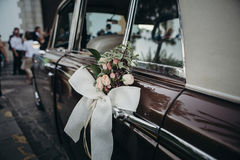 Wedding ornament decoration in a classic car. Royalty Free Stock Image