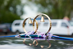Wedding ornament by rings. Wedding ornament in the form of rings with hand bells for a limusine Royalty Free Stock Photography