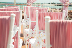 Wedding outdoor decoration of chairs with flowers Royalty Free Stock Photos