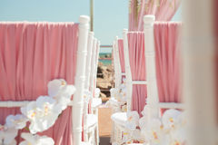 Wedding outdoor decoration of chairs with flowers Stock Photos