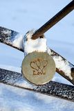 Wedding padlock in the winter. Wedding padlock hanging covered in frost, snow, frost royalty free stock images