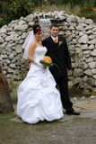 Wedding pair in front of watterfall. Bride and groom staying in front of waterfall Royalty Free Stock Photos