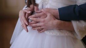 Wedding pair holding hands stock video
