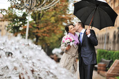 Wedding pair hugging and kissing - outdoors Stock Images