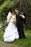 Wedding pair in park. Bride and groom before the kissing Royalty Free Stock Photos
