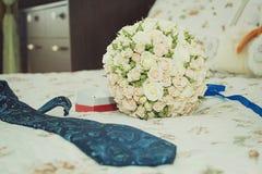Wedding paraphernalia of the groom. Decorating a wedding car - wedding rings. Wedding paraphernalia of the groom stock photography