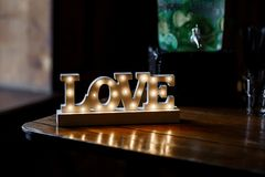 Shining LOVE letters decoration. Wedding party accessory and decoration. Letter light stock photo