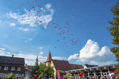 Wedding party and ballons in the old town of Gengenbach Royalty Free Stock Image