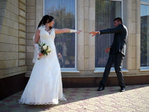 Wedding party. The bride and groom look at each other. Stock Image
