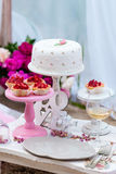 Wedding or party candy bar, decorated dessert table in pink color with cakes. Shabby chic style Stock Photography