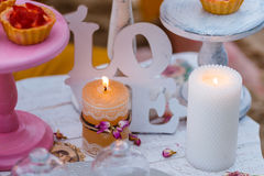 Wedding or party candy bar, decorated dessert table in pink color with cakes. Shabby chic style.  Royalty Free Stock Photography