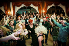 Wedding party dance. Crowd dancing with their hands in the air at a wedding party royalty free stock photos