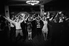 Wedding party dance. Crowd dancing with their hands in the air at a wedding party stock photos