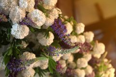 Wedding or party decoration of white and purple flowers. Arc decorated with lupines stock photography