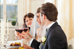 Wedding party at dinner stock images