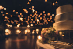 Wedding party evening. Blurred dance floor and wedding cake.