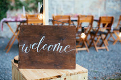 Wedding and party place decoration. With wooden welcome sign Stock Photos
