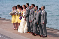 Wedding Party Prepares For Picture On Waterfront Royalty Free Stock Photos