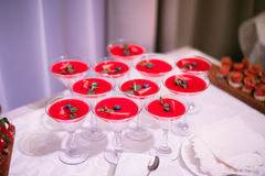 Wedding Party. Red cocktails in glasses ready for party people Stock Image