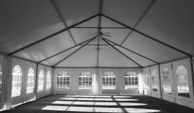 Wedding Party Tent interior. White wedding, Party or event Tent interior view, black and white Royalty Free Stock Image