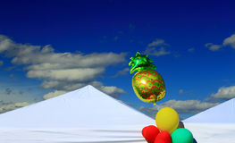 Party Event Tents balloons. White wedding, Party or event Tent with Balloon on Blue Sky Royalty Free Stock Photo
