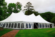 Wedding Party Tent. White wedding, Party or event Tent in wood with green grass lawn and red brick path stock photography