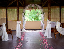 Wedding Path Rose Petals. Rose petals line the bridal path leading to the wedding arch Stock Image