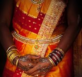 Wedding pattern. Bangles, rings and wedding pattern on hands stock photo