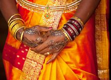 Wedding pattern. Bangles, rings and wedding pattern on hands stock photography