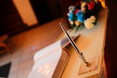 Wedding Pen. The guest book pen in focus royalty free stock photos