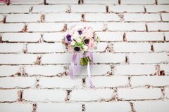 Wedding Peonies Bouquet on Brick Wall Background Royalty Free Stock Images