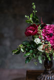 Wedding peony bouquet against vintage dark stone background. Rustic style. Stock Photos