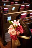 Wedding pew flowers Stock Images