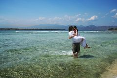 Wedding photo 2. Photo of just married couple taken on the beach of Indian ocean Royalty Free Stock Images