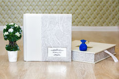 Wedding photo book, decorative tree and jewelry gift box Stock Photography