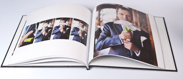 Wedding photo book of elegant young caucasian groom Royalty Free Stock Image