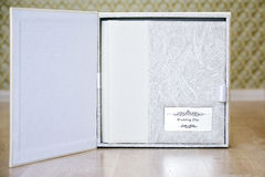 Wedding photo book with leather combined cover and metal shield Royalty Free Stock Photography