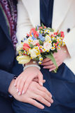 Wedding photo. Wedding details/Hands love flowers Stock Photo