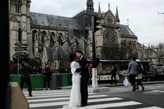 Wedding photo session Notre Dame de Paris France 03.20.2019 royalty free stock photo