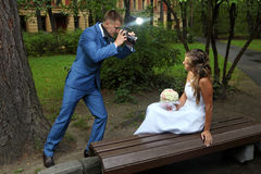 Wedding photo shoot, a newlywed with a camera, take pictures bri Royalty Free Stock Image