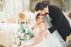 Free Wedding Photo Shoot Of The Newlyweds Couple Posing In A Beautiful Hotel Stock Photo - 100637140