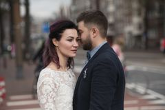 Wedding photo shooting. Bride and bridegroom walking in Amsterdam. Netherlands stock photo